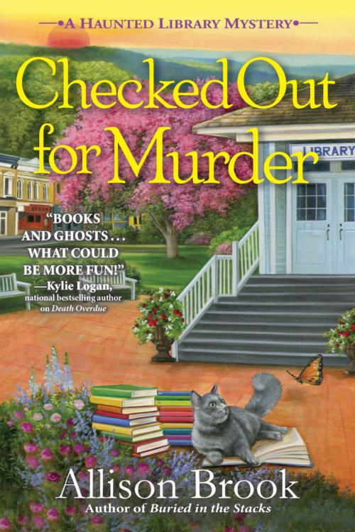 Book Cover. Checked Out for Murder by Allison Brook. Cat sitting on a book outside of a library.