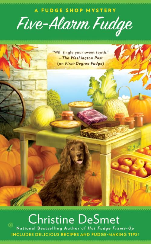 Book Cover. Five-Alarm Fudge - A Fudge Shop Mystery by Christine DeSmet. Dog sitting by a table with fudge and pies, surrounded by pumpkins and fall leaves.