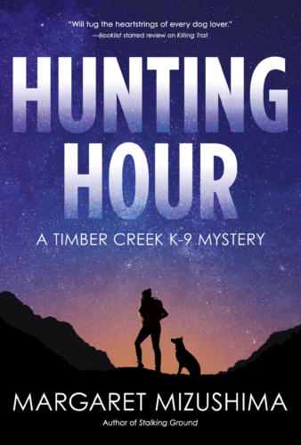 Book Cover. Hunting Hour by Margaret Mizushima. A Timber Creek K-9 Mystery. Silhouette of a person and a dog on a starry sky.