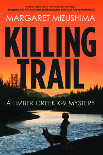 Book Cover, Killing Trail by Margaret Mizushima. A Timber Creek K-9 Mystery. Silhouette of person and dog in front of a river and an orange sunset.