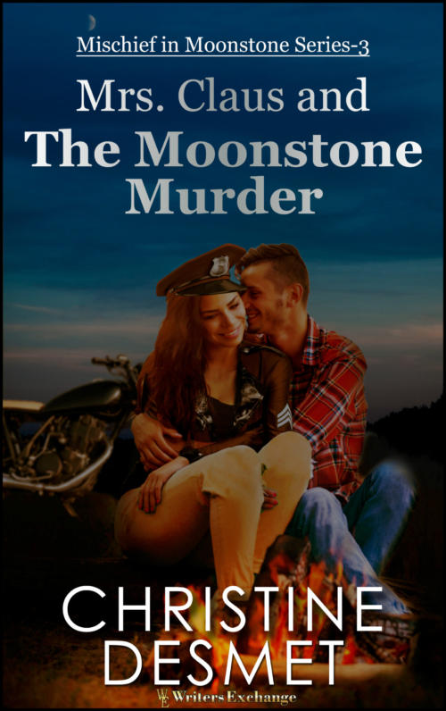 Book Cover. Mrs. Claus and the Moonstone Murder. Mischief in Moonstone Series-3 by Christine DeSmet. Woman in a man's arms sitting in front of a fire with a motorcycle in the background.